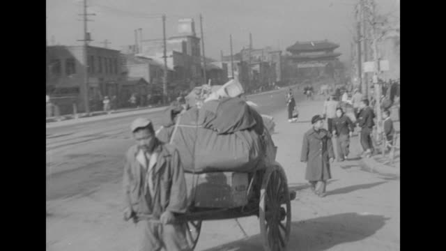 refugees move along a roadway with their belongings in south korea during the korean war. - 1951 stock videos & royalty-free footage