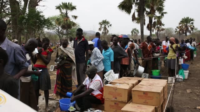 refugees queue at a world food programme food distribution site at a refugee settlement on february 25 2017 in palorinya uganda after registering... - charity and relief work stock videos & royalty-free footage
