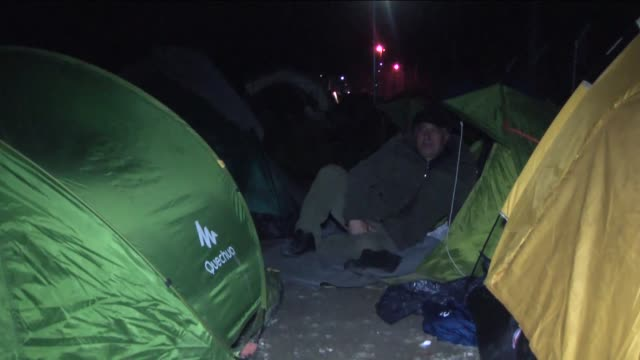 refugees seen at the greekmacedonian border near the greek village of idomeni on march 1 where thousands of people are stranded with austria and... - makeshift stock videos & royalty-free footage