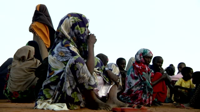 refugees sitting and waiting at refugeee camp on july 30, 2011 in dadaab, kenya - horn of africa stock videos & royalty-free footage