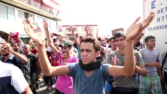 refugees stage a protest demanding to board a ferry boat, in the port of mytilene in lesbos island, greece on september 07, 2015. refugees demand... - 2015 stock-videos und b-roll-filmmaterial
