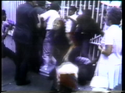 refugees stand at the gates of the united states embassy in saigon trying to secure a place on one of the evacuation helicopters in 1975. - (war or terrorism or election or government or illness or news event or speech or politics or politician or conflict or military or extreme weather or business or economy) and not usa stock videos & royalty-free footage