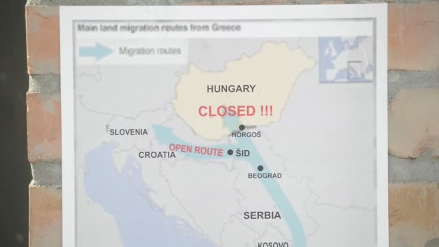 refugees stand in a tent in a camp in kanjiza, serbia on thursday, september 17, 2015 shots: a map is posted on the wall of the camp, explaining that... - serbia stock videos & royalty-free footage