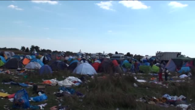 refugees wait at the control and registration tent camp in roszke on september 9 2015 in budapest hungary refugees are planning to enter austria... - zoll und einwanderungskontrolle stock-videos und b-roll-filmmaterial