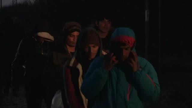 Refugees walk along a railway in Sid near the Serbia Croatia border as they try to enter Croatia near Serbian town of Sid on November 14 2016 Nearly...