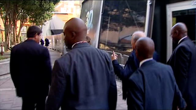 refuse to comment on goal-line technology; johannesburg: sepp blatter along past as minder puts hand up to camera to prevent filming blatter along... - fifa stock videos & royalty-free footage