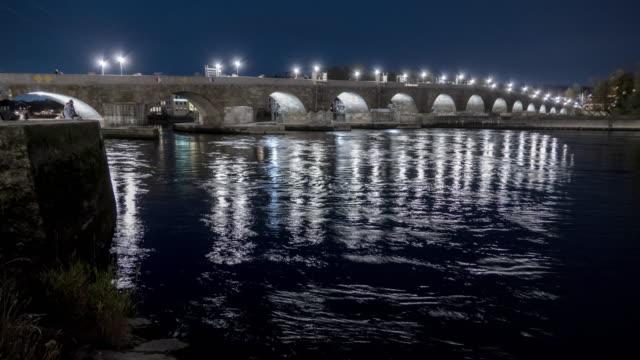 regensburg ratisbona bavaria danubio river stone bridge at night timelapse - regensburg stock videos & royalty-free footage