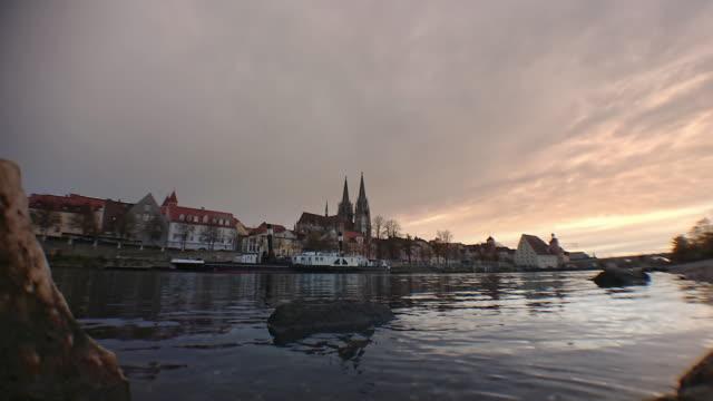 regensburg ratisbona bavaria danubio river with catedral and stone bridge timelapse - regensburg stock videos & royalty-free footage