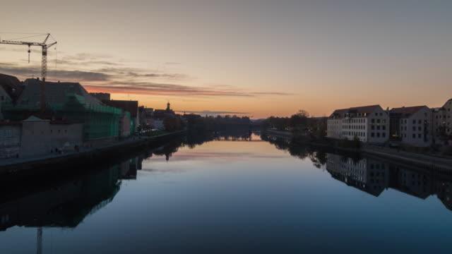 regensburg ratisbona bavaria danubio river with houses and sunset hyperlapse silhouette - omega sun mirage stock videos & royalty-free footage