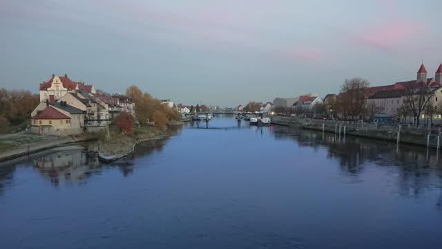 regensburg ratisbona bavaria danubio river with houses and sunset timelapse - regensburg stock videos & royalty-free footage