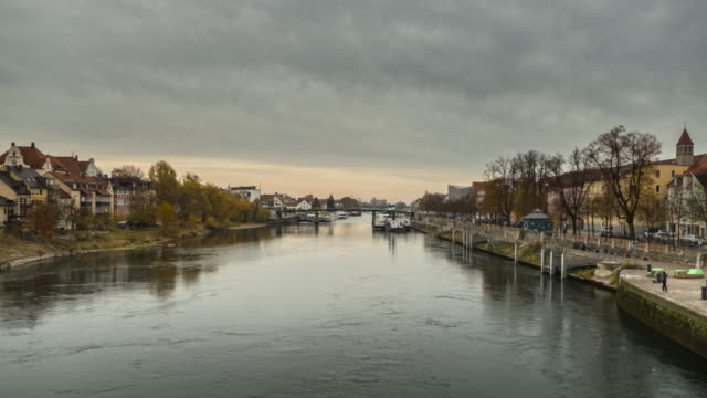 regensburg ratisbona bavaria danubio river with houses and sunset hyperlapse - regensburg stock videos & royalty-free footage