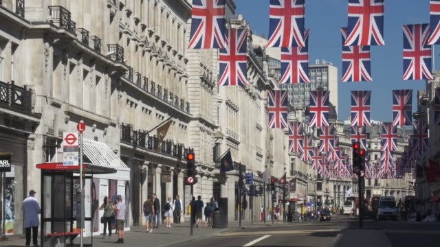 Regent St early morning with Union Jacks and Red Buses