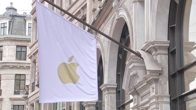 london regent street ext gvs staff at work in apple store including sign for iphone x / apple flag flying outside store people queuing up in street /... - apple store stock videos & royalty-free footage