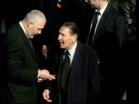 Reggie Kray funeral GV Hearse carrying Reggie Kray's coffin towards with words 'Respect' in flowers on side MS Frankie Fraser speaking to man at...