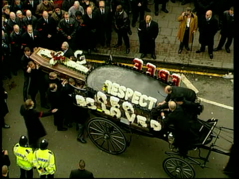reggie kray funeral paul england east london coffin of reggie kray carried along past by pall bearers tgv coffin placed in back of horse drawn... - funeral procession stock videos & royalty-free footage