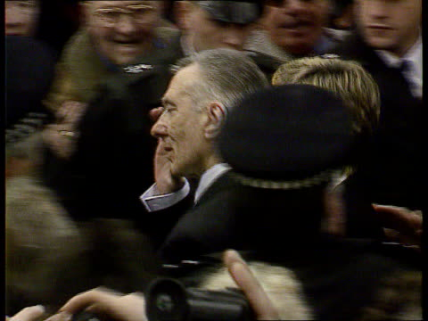 Reggie Kray to be freed on compassionate grounds LIB Reggie Kray along thru crowds at funeral of his brother Ronnie PAN Reggie Kray kissed by woman...