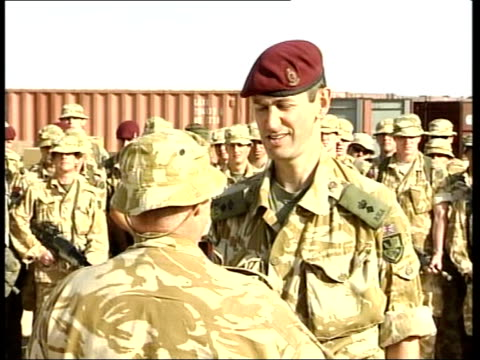stockvideo's en b-roll-footage met regime reaction/northern iraq: baghdad prepares for war; uk pool kuwait ext air views military encampments in the desert int helicopter cbv soldier... - british military