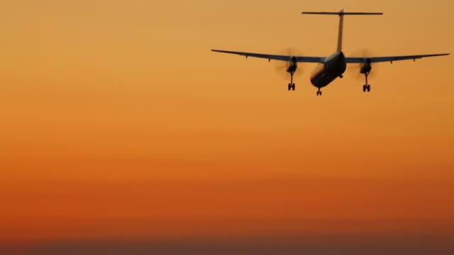 HD regional airplane landing at sunset
