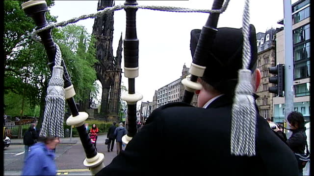 regional and local elections / av referendum results general view of people walking along street as bagpipes heard playing sot various views of piper... - tartan stock videos & royalty-free footage