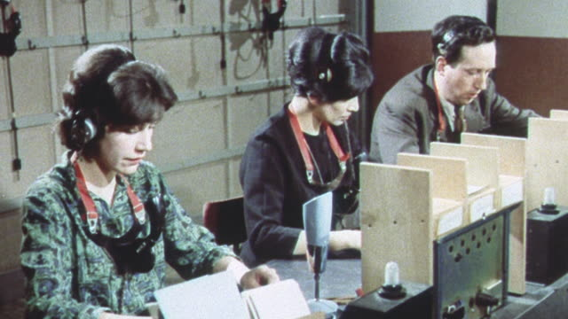 1962 ds regional civil defense communications staff transmitting nuclear fallout and bomb blast information to all necessary government agencies in a cold war training exercise / united kingdom - 1962年点の映像素材/bロール