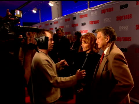 VS Regis and Joy Philbin interviewing w/ reporters in FG ZI to BG Steve Van Zandt Chuck Barris and group of people conversing on red carpet