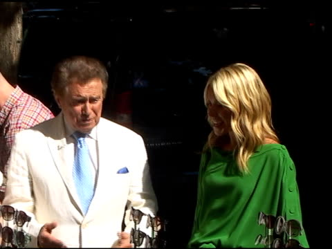 regis philbin and kelly ripa look over the latest designer shades on the set of 'live with regis kelly in new york 07/05/01 - regis philbin stock videos and b-roll footage
