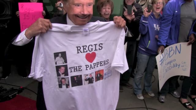 regis philbin shows off his new tshirt as he arrives at 'good morning america' in new york 11/15/11 - regis philbin stock videos and b-roll footage
