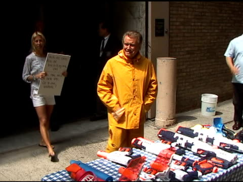 regis philbin signs autographs for fans before his water fight on the set of 'live with regis kelly' in new york 06/08/11 - autographing stock videos and b-roll footage