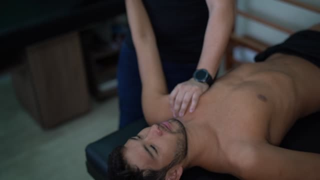 rehabilitation after shoulder injury - osteopath stock videos & royalty-free footage