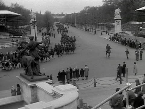 A rehearsal of the Coronation procession for Queen Elizabeth II The mounted cavalry move down the Mall 1953