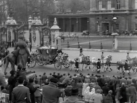 a rehearsal of the coronation procession for queen elizabeth ii the gold state coach moves out of buckingham palace and past the victoria memorial... - coronation of queen elizabeth ii stock videos and b-roll footage
