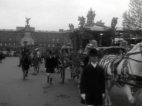 a rehearsal of the coronation procession for queen elizabeth ii the gold state coach attendants and cavalry guard proceed down the mall 1953 - coronation stock videos and b-roll footage