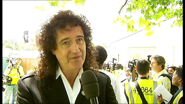 rehearsals and interviews for nelson mandela's 90th birthday concert brian may interview sot on mandela's charity 46664 / on size of audience /... - 90th birthday stock videos and b-roll footage