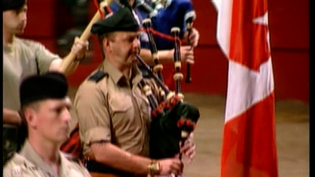 rehearsals begin for british military tournament in december bsp020899037 / tx earls court int soldiers from scottish regiment playing bagpipes... - earls court stock videos & royalty-free footage