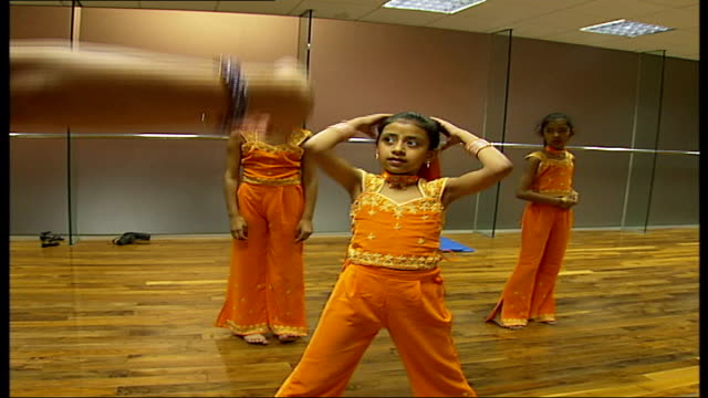 rehearsals in bollywood dance class for children with award winning 8 year old dancer bajaria instructing class asking for more facial expression sot - bollywood stock videos and b-roll footage