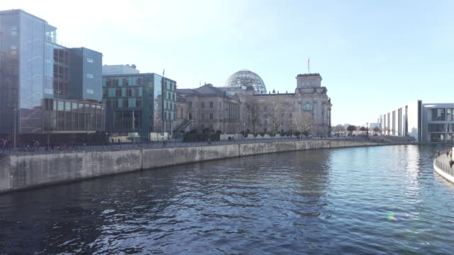 reichstag building over the river spree in berlin general views on february 07 2019 in berlin germany - スプリー川点の映像素材/bロール