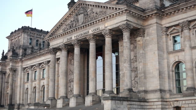reichstag in berlin with german flag - the reichstag stock videos & royalty-free footage