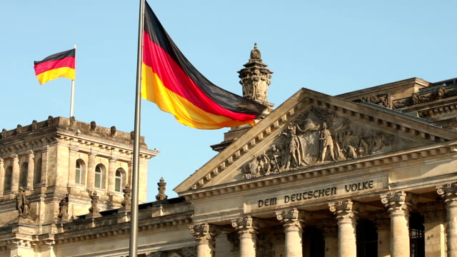reichstag in berlin with two flaggs - the reichstag stock videos & royalty-free footage