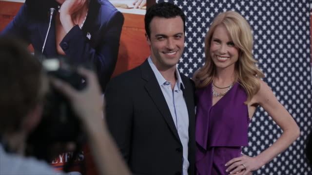 Reid Scott and Elspeth Keller posing for paparazzi on the red carpet at the Paramount Theater