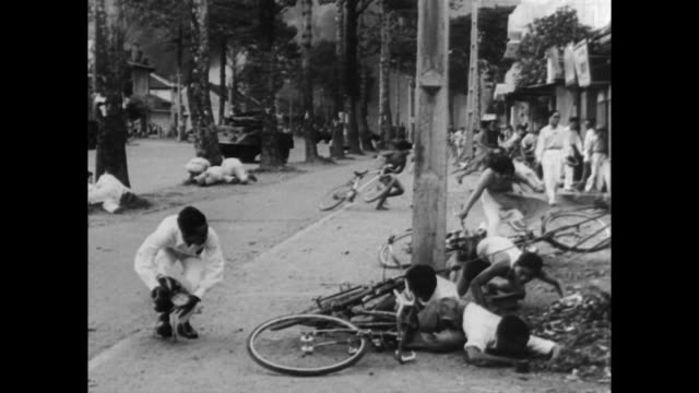 A reign of terror is launched in Saigon as rebel factions attempt to unseat the USbacked regime of Premier Ngo Dinh Diem / in savage street fighting...