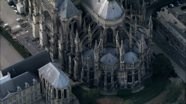 reims cathedral  - aerial view - champagne-ardenne, marne, arrondissement de reims, france - cathedral stock videos & royalty-free footage