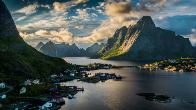 aerial: reine village and mountains of moskenesoya, lofoten islands in norway - landscape scenery stock videos & royalty-free footage