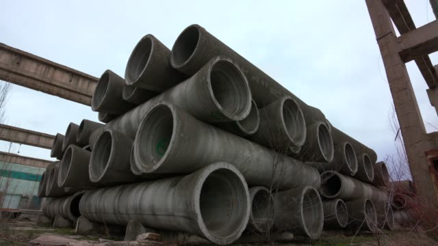 reinforced concrete pipes in abandoned area - concrete stock videos & royalty-free footage