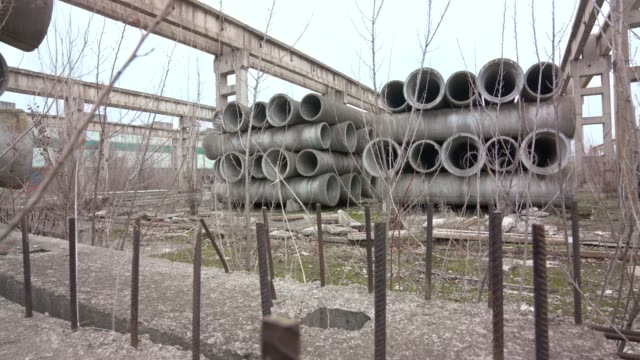 reinforced concrete pipes in abandoned area - folded stock videos & royalty-free footage