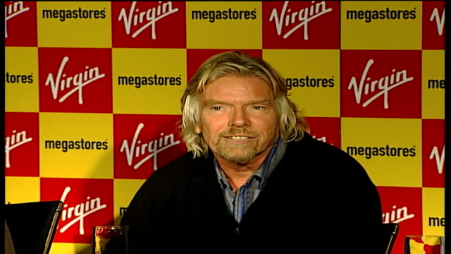 sir richard branson condemns murdoch shares purchase: branson press conference; england: manchester: virgin megastore: int sir richard branson press... - news of the world stock-videos und b-roll-filmmaterial
