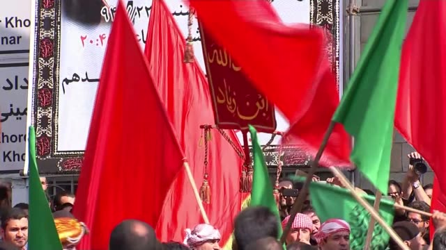 tehran ext various shots day of ashura being commemorated in ceremony [battle that established the shia community in islam] [shia wear green and... - muharram stock videos & royalty-free footage