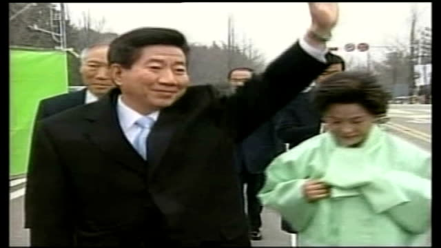relations strained following north korean nuclear test; seoul: south korean president, roh moo-hyun first lady kwon yang-sook as roh waving and... - roh moo hyun stock videos & royalty-free footage