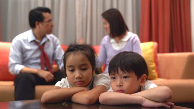 relationship problems. frustrated couple having an argument with each other.portrait of a sad son and a daughter bored or tired of parents fighting, frustrated little boy and girl upset of mom dad shouting, a preschool child looking at camera feeling lack - scolding stock videos & royalty-free footage