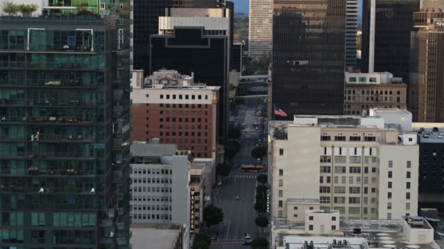 relative quiet on flower st, downtown los angeles during covid-19 lockdown - famous place stock videos & royalty-free footage