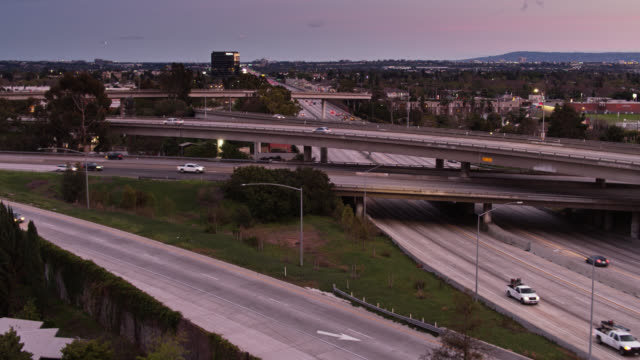 relative quiet on la freeways during covid-19 pandemic at sunset - social distancing stock videos & royalty-free footage